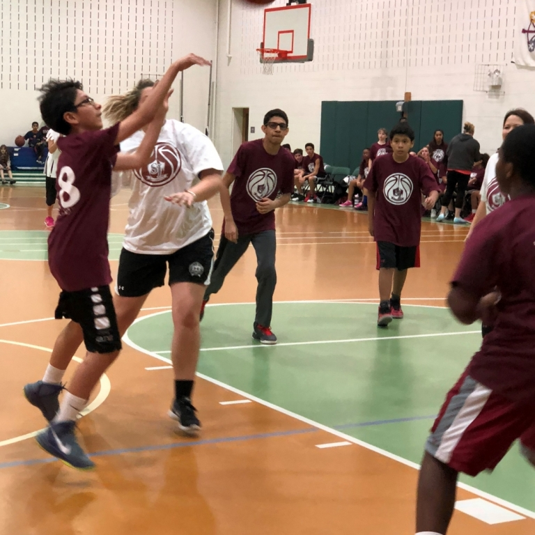 Former eighth grade student goes head-to-head with Ms. Kiersten Paul at the eight grade versus faculty game 2018