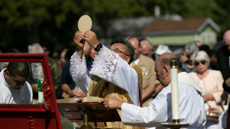 Father Lee consecrates the Eucharist at the Father Kapaun Mass on Friday, September 20