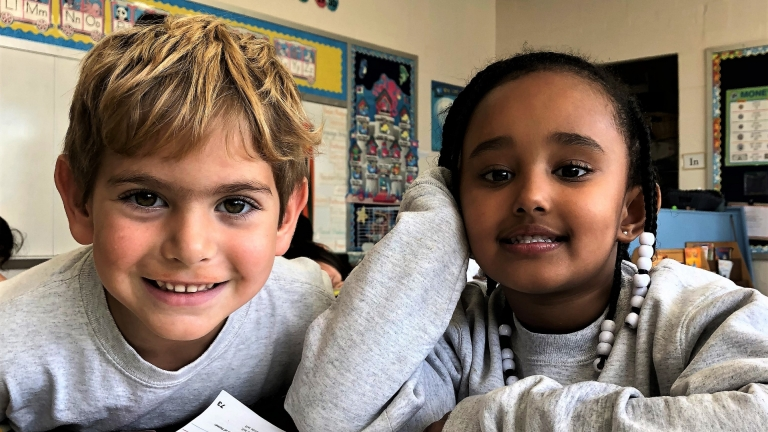 Two Kindergarten students smile for the camera